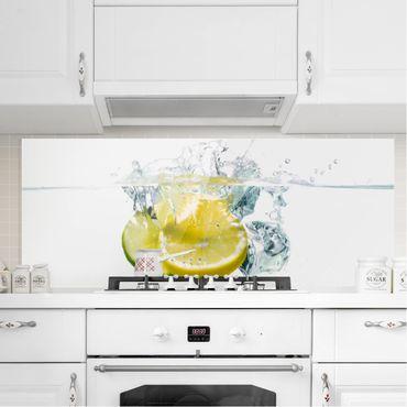 Spritzschutz Glas - Zitrone und Limette im Wasser - Panorama - 5:2