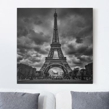 Leinwandbild - Eiffelturm vor Wolken schwarz-weiß - Quadrat 1:1