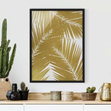 Bild mit Rahmen - Blick durch goldene Palmenblätter - Hochformat
