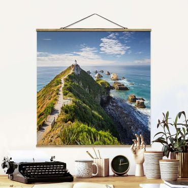Stoffbild mit Posterleisten - Nugget Point Leuchtturm und Meer Neuseeland - Quadrat 1:1