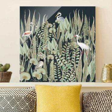 Glasbild - Flamingo und Storch mit Pflanzen auf Grün - Quadrat