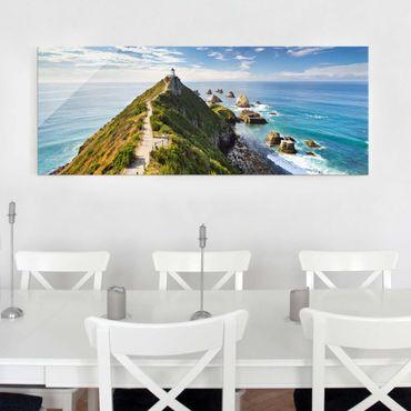 Glasbild - Nugget Point Leuchtturm und Meer Neuseeland - Panorama Quer