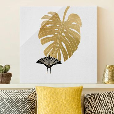Glasbild - Goldene Monstera mit Schmetterling - Quadrat