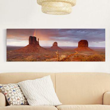 Leinwandbild - Monument Valley bei Sonnenuntergang - Panorama Quer