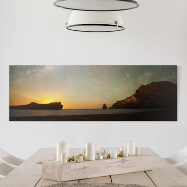 Leinwandbild - Sternenhimmel über dem Meer - Panorama Quer