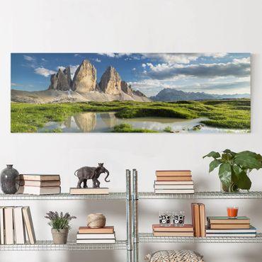 Leinwandbild - Südtiroler Zinnen und Wasserspiegelung - Panorama Quer