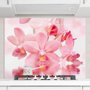 Spritzschutz Glas - Rosa Orchideen auf Wasser - Quer 4:3