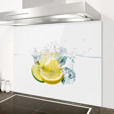Spritzschutz Glas - Zitrone und Limette im Wasser - Quer 2:1