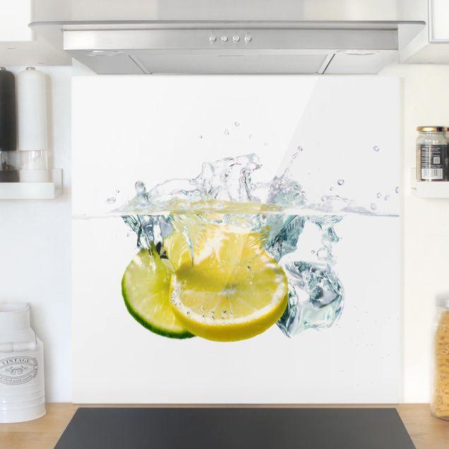Glas Spritzschutz - Zitrone und Limette im Wasser - Quadrat - 1:1