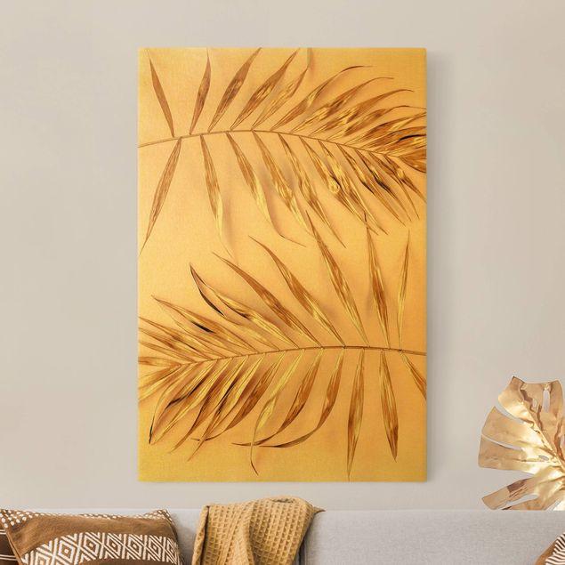 Leinwandbild Gold - Goldene Palmenblätter auf Rosa - Hochformat 2:3