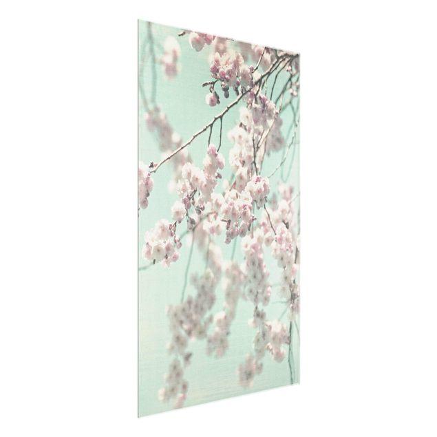Glasbild - Kirschblütentanz auf Leinenstruktur - Hochformat