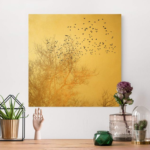 Leinwandbild Gold - Vogelschwarm vor goldenem Baum - Quadrat 1:1