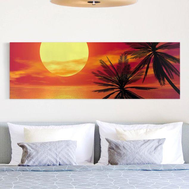 Leinwandbild - Karibischer Sonnenuntergang - Panorama Quer