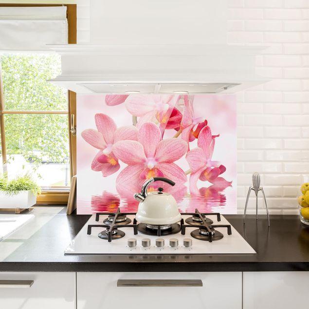 Spritzschutz Glas - Rosa Orchideen auf Wasser - Quer 3:2