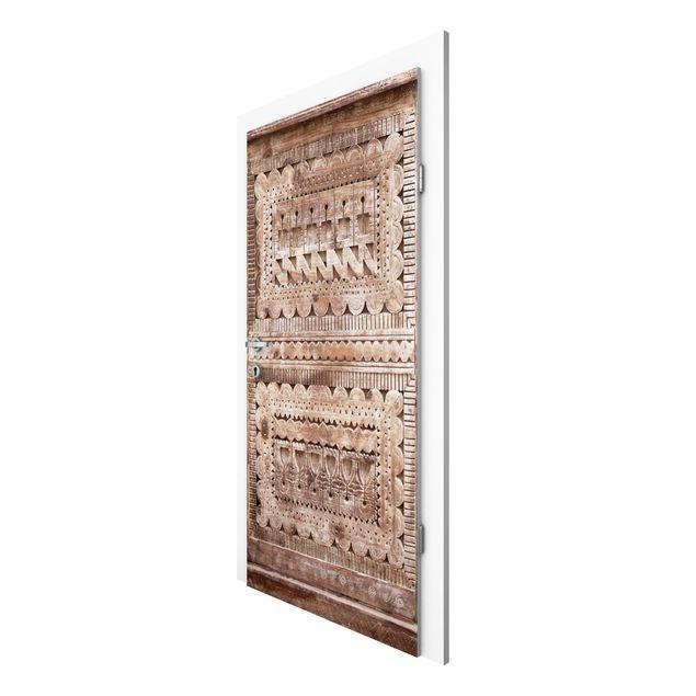 Türtapete - Alte verzierte marokkanische Holztür in Essaouria